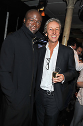 Left to right, singer SEAL and PERRY OOSTING President of Vertu at a party to celebrate the launch of the new Vertu Constellation phone - the luxury phonemakers first touchscreen handset, held at the Farmiloe Building, St.John Street, Clarkenwell, London on 24th November 2011.