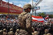 Soldiers and riot squad officers stand guard as supporters of ousted Honduran President, Manuel Zelaya, participate in a protest against the military coup near Toncontin international airport in Tegucigalpa on July 5, 2009. *** SUMMARY: In the early hours of Sunday, June 28, Honduran military burst into the home of President José Manuel Zelaya and is transported to a military airbase to be deposited in Costa Rica. President's supporters take to the streets in protest and are retracted by the army and police for several days, the strongest protest occurred on June 5 on the outskirts of Toncontín International Airport in Tegucigalpa, where a young man was killed by a shot of soldiers.
