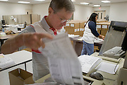 Nov. 3, 2008 -- PHOENIX, AZ: Elections workers count mail in ballots in Phoenix, AZ, Monday. Election officials have started counting mail in and early ballots at the Maricopa County Tabulation and Election Center in Phoenix, AZ. Officials said they mailed out more than 800,000 early ballots.  Photo by Jack Kurtz / ZUMA Press