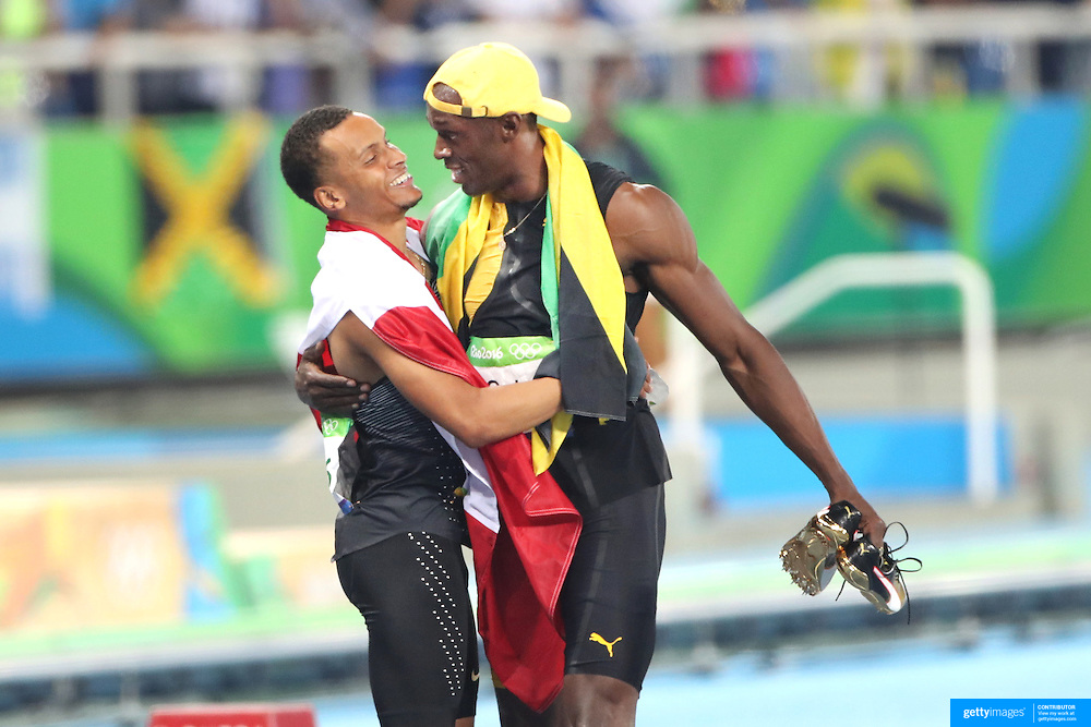 Athletics - Olympics: Day 9  Gold medal winner Usain Bolt of Jamaica after winning the Men's 100m Final, congratulates bronze meal winner Andre De Grasse, (left), of Canada at the Olympic Stadium on August 14, 2016 in Rio de Janeiro, Brazil. (Photo by Tim Clayton/Corbis via Getty Images)