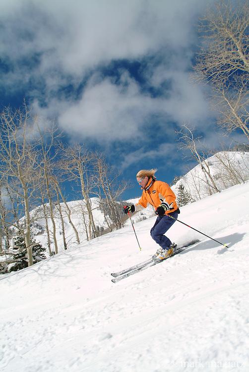 Jill skiing groomer at The Canyons, Park City, Utah USA