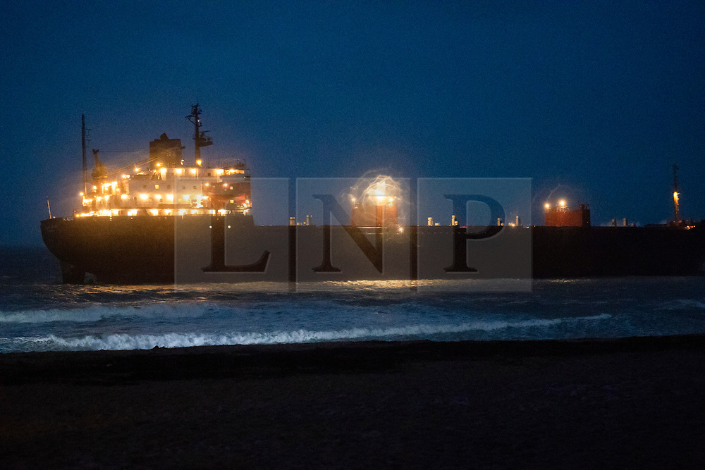 © Licensed to London News Pictures. 18/12/2018. Falmouth, UK. Russian cargo ship Kuzuma Minin ran aground on the reef off Gyllyngvase beach in Falmouth Bay in the early hours this morning. The Falmouth lifeboat and the Coastguard helicopter are involved in the major incident.  Photo credit: Mark Hemsworth/LNP