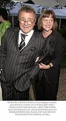 MR & MRS JOSEPH ETTEDGUI, he is designer Joseph, at a dinner in London on 21st May 2001.OOK 1
