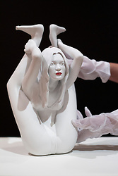 © Licensed to London News Pictures. 08/10/2012. LONDON, UK. A member of Bonhams staff handles 'Cayratid' (2008) a sculpture of model Kate Moss in a yoga position by artist Marc Quinn (est. GB£50,000-70,000) ahead of a sale at the auction house's New Bond Street premises. The auction, featuring a collection of contemporary art and design is set to take place on Thursday the 11th of October at Bonham's New Bond Street auction house. Photo credit: Matt Cetti-Roberts/LNP