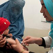 Afghan Turk clinic , Taloqan . Zanegar,vaccinator.