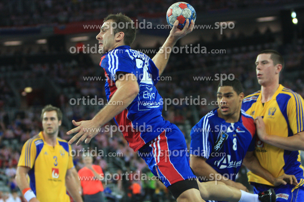 Michael Guigou (21) of France during 21st Men's World Handball Championship 2009 Main round Group I match between National teams of France and Sweden, on January 24, 2009, in Arena Zagreb, Zagreb, Croatia.  (Photo by Vid Ponikvar / Sportida)