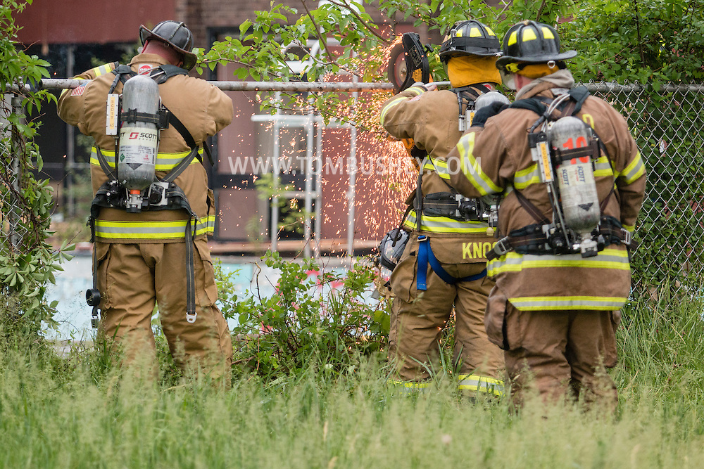 Middletown, New York - Firefighters battle a blaze at an abandoned building at the former Middletown Psychiatric Center on May 27, 2015.