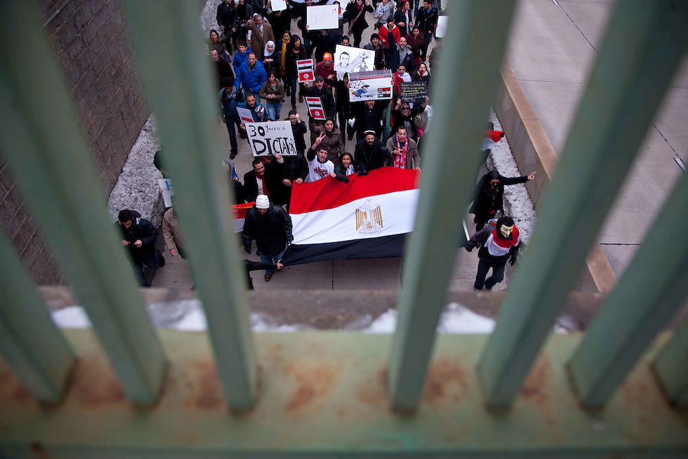 After the first uprisings in Egypt, sympathetic ex-patriats and protesters gathered at the Egyptian Embassy in Washington, DC for a march to the White House.