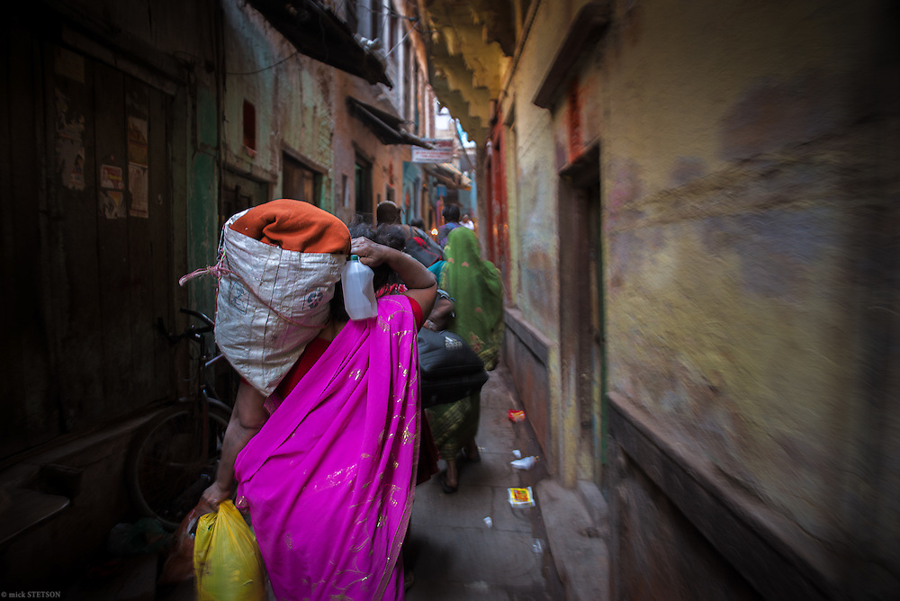 — The alleys of Varanasi's old city lead crowds of devotees to the Ganga River for their cleansing rituals. For many Hindus who live beside the Ganga, this is a daily routine.