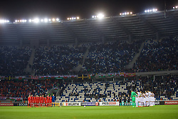 TBILSI, GEORGIA - Friday, October 6, 2017: Wales players stand for a minute's silence before the 2018 FIFA World Cup Qualifying Group D match between Georgia and Wales at the Boris Paichadze Dinamo Arena. Aaron Ramsey, Chris Gunter, captain Ashley Williams, James Chester, Ben Davies, Tom Lawrence, Andy King, Joe Allen, Sam Vokes, Joe Ledley and goalkeeper Wayne Hennessey. (Pic by David Rawcliffe/Propaganda)