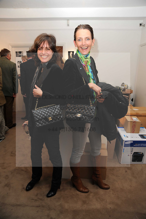 Left to right, ? and SAFFRON ALDRIDGE at a private view of photographs by Nick Ashley held at the Sladmore Gallery, 32 Bruton Place, London on 13th January 2010.