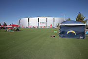 San Diego Chargers fans and Arizona Cardinals fans set up their tents early in this general view photograph of the exterior facade of the University of Phoenix Stadium from the Great Lawn before the Arizona Cardinals 2015 NFL preseason football game against the San Diego Chargers on Saturday, Aug. 22, 2015 in Glendale, Ariz. (©Paul Anthony Spinelli)