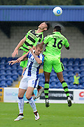 Forest Green Rovers striker Keiffer Moore (14) and Forest Green Rovers defender Ethan Pinnock (16) wins a header 0-1 during the Vanarama National League match between Chester and Forest Green Rovers at the Deva Stadium, Chester, United Kingdom on 3 September 2016. Photo by Alan Franklin.