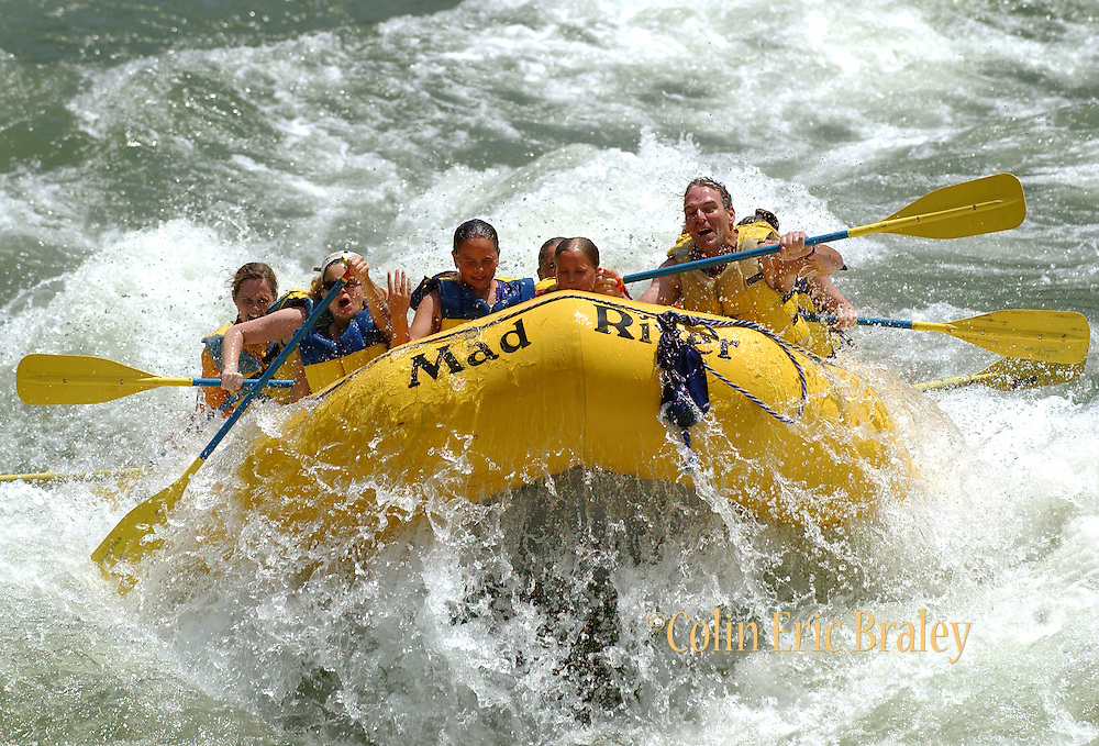 """Rafters make their way through the """"Lunch Counter"""" rapids on the Snake River in Wyoming. Several commercial river running companies, based near Jackson, Wyoming, make running the Snake River accessible for thousands of adventure seekers each season."""