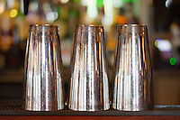 Close-up view of three steel glass kept upside down