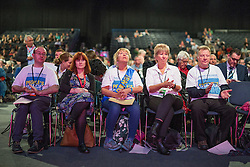 "© Licensed to London News Pictures . 24/09/2014 . Manchester , UK . Delegates wearing ""SAVE OUR NHS"" saches and t-shirts at the conference . The Labour Party Conference 2014 . Photo credit : Joel Goodman/LNP"