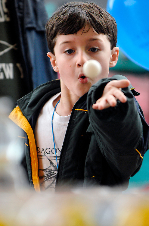 Aiden O'Connor, 7, of Vienna, keeps his eye on the target while trying to win at Wacky Water, while attending Viva Vienna festivities with his family.