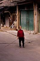 Old woman on the streets of Baisha near Yangshuo, China.