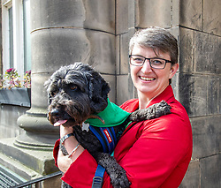 Pictured: Maggie Chapman was joined by Dougal the rescue dog for the important vote. Dougal had his own views on electors who may not vote Green<br />