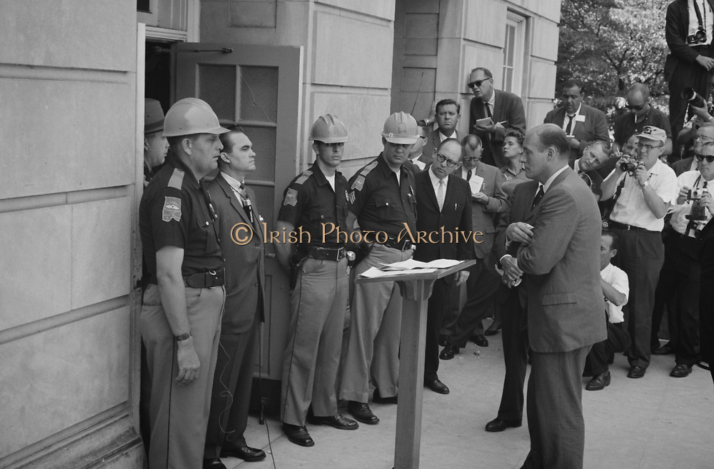 George Wallace (1919-1998) Governor of Alabama for four terms between 1963 and 1987. Wallace attempting to block integration at the University of Alabama,  standing defiantly at a door while being confronted by  US Deputy Attorney General Nicholas Katzenbach,  11 June 1963.  Photographer:  Warren K  Leffler.