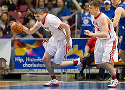 Bridgeport guard forward Nick Greely (34) gets a rebound and drives the ball up the floor against Fairmont Senior during a semi-final game at the Charleston Civic Center.