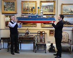Bonham's Managing Director Charles Graham-Campbell and head of the sale Kenneth Naples inspect a mid 20th century model of Russian battleship 'Admiral Oushavov' which is up for sale in the nautical collection auction at Bonham's in Edinburgh on November 15th.<br /> <br /> &copy; Dave Johnston/ EEm