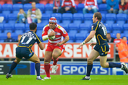 Wigan, England - Thursday, July 12, 2007: Wigan Warriors' Iafeta Paleaaesina charges through the Leeds Rhinos' defence during the Super League match at the JJB Stadium. (Photo by David Rawcliffe/Propaganda)