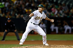 OAKLAND, CA - SEPTEMBER 16: Jake Diekman #35 of the Oakland Athletics pitches against the Kansas City Royals during the fifth inning at the RingCentral Coliseum on September 16, 2019 in Oakland, California. The Kansas City Royals defeated the Oakland Athletics 6-5. (Photo by Jason O. Watson/Getty Images) *** Local Caption *** Jake Diekman