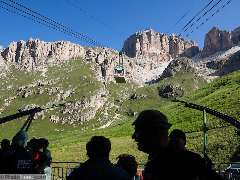 A lift from Passo Pordoi up to Sass Pordoi in the Sella Group gives a sweeping view of Dolomites peaks including their highest, glacier-clad Marmolada (3343 meters / 10,968 feet), Italy. From Pordoi Pass on state highway 48 (Grand Strader delle Dolomiti), take the rapid cable car ascent or hike up to the restaurant on Sass Pordoi at 2952m. Pordoi Pass (or Pordoijoch, 2239 meters/7346 feet) is the highest surfaced road traversing a pass in the Dolomites. The Dolomites are part of the Southern Limestone Alps, Europe. UNESCO honored the Dolomites as a natural World Heritage Site in 2009.