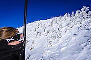 Young woman on chairlift at Mammoth Mountain Ski Area, Mammoth Lakes, California USA