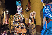 Giant paper-mache puppets called mojigangas lead a procession through the historic district during the week long fiesta of the patron saint Saint Michael September 26, 2017 in San Miguel de Allende, Mexico.