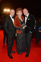 Left to right, JEREMY HACKETT, RULA LENSKA and CHARLES JEFFERIES,at the Collars & Coats Gala Ball in aid of Battersea Dogs & Cats Home held at Battersea Evolution, Battersea Park, London on 7th November 2013.