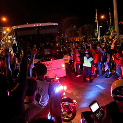 Jun 21, 2012; Miami, FL, USA; Miami Heat fans celebrate outside as the team bus for the Oklahoma City Thunder passes following the 2012 NBA Finals at the American Airlines Arena. Miami won 121-106. Mandatory Credit: Derick E. Hingle-USA TODAY SPORTS