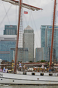 The JR Tolkien passing Canary Wharf - Royal Greenwich Tall Ships Festival with a fleet of square rigged ships moored on the Thames at Greenwich and Woolwich. The fleet includes two of the biggest Class A Tall Ships - the Dar Mlodziezy and Santa Maria Manuela - which are moored on Tall Ships Island in the river off Greenwich. Tall Ships Festival Day on Saturday 29 August featured free family entertainment and the chance to enjoy a taste of life on the high seas.