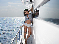 Young woman posing on yacht
