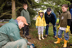 United States, Washington, Issaquah, children learning how to plant tree seedlings, Social Venture Partners community service project with Mountains to Sound Greenway Trust.   MR