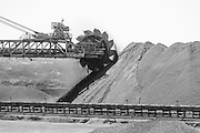 Pile construction equipment, iron ore scooper - black and white image