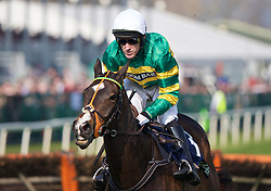 LIVERPOOL, ENGLAND - Thursday, April 9, 2015: Jezki, ridden by AP McCoy [Anthony Peter McCoy] during the fourth race, the Doom Bar Aintree Hurdle Grand, on the Opening Day on Day One of the Aintree Grand National Festival at Aintree Racecourse. (Pic by David Rawcliffe/Propaganda)