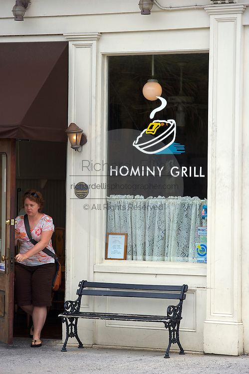 A customer leaves Hominy Grill restaurant in Charleston, SC. Charleston founded in 1670 is considered America's most beautifully preserved architectural and historic city.