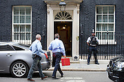 Prime Minister David Cameron arrives in Downing Street on 20th August 2014 after curtailing his holiday in Cornwall to chair a Security Council meeting following the apparent beheading video of kidnapped American Journalist James Wright Foley issued by the ISIS group in Iraq. <br />