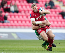 Scarlets' Hadleigh Parkes is tackled<br /> <br /> Photographer Simon King/Replay Images<br /> <br /> EPCR Champions Cup Round 3 - Scarlets v Benetton Rugby - Saturday 9th December 2017 - Parc y Scarlets - Llanelli<br /> <br /> World Copyright © 2017 Replay Images. All rights reserved. info@replayimages.co.uk - www.replayimages.co.uk