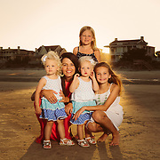 Images from a family beach portrait session with the Johnson family on Isle of Palms beach near Charleston, SC.