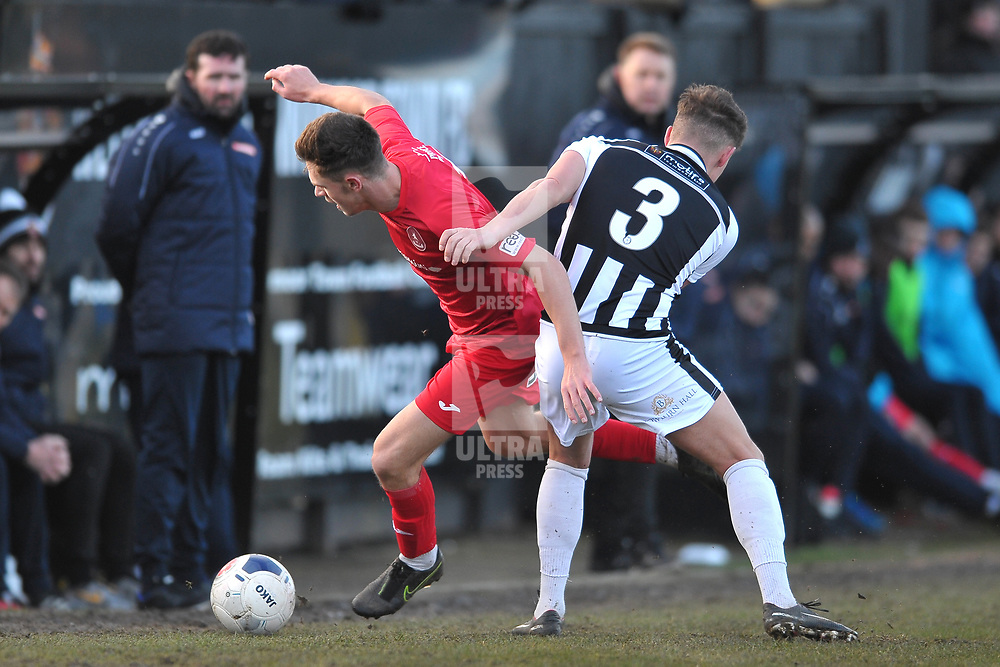TELFORD COPYRIGHT MIKE SHERIDAN  Ryan Barnett of Telford is tackled by Stephen Brogan during the Vanarama Conference North fixture between Spennymoor Town and AFC Telford United at Brewery Field, Spennymoor on Saturday, February 29, 2020.<br /> <br /> Picture credit: Mike Sheridan/Ultrapress<br /> <br /> MS201920-048