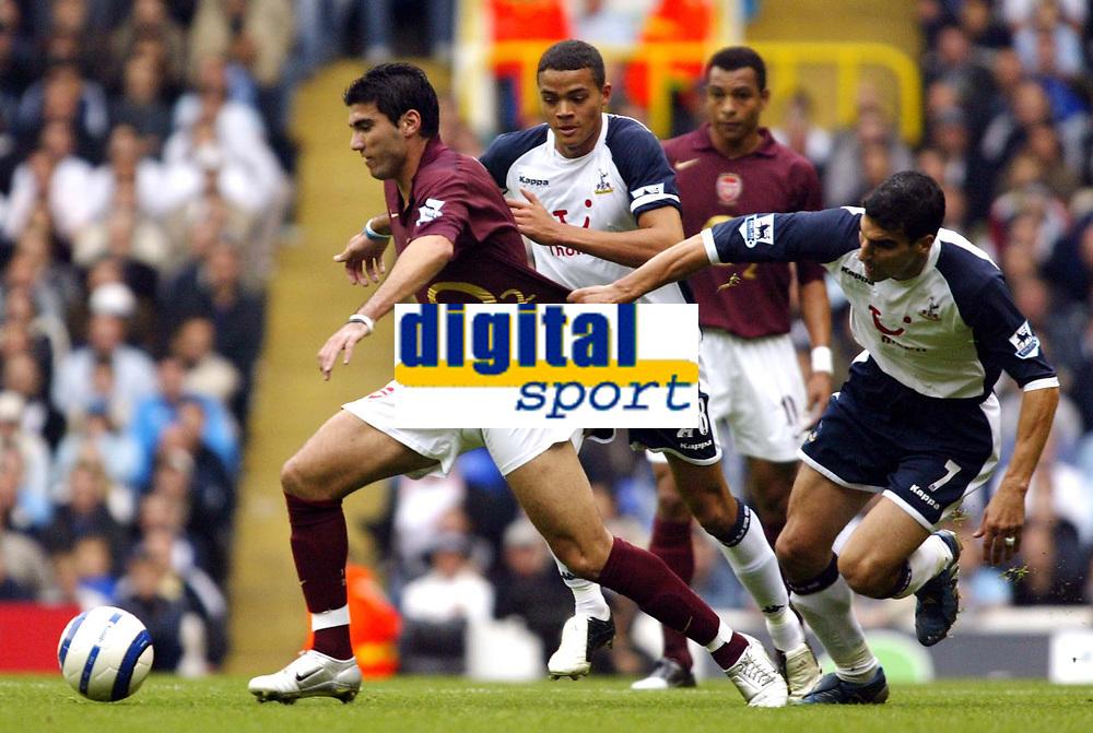 Photo: Chris Ratcliffe.<br />Tottenham Hotspur v Arsenal. The Barclays Premiership.<br />29/10/2005.<br />Paul Stalteri and Jermaine Jenas of Spurs hold back Jose Antonio Reyes of Arsenal