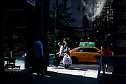 Street scene of people and cars near Grand Central Station