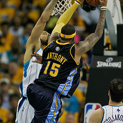 25 April 2009: Denver Nuggets forward Carmelo Anthony (15) shoots over New Orleans Hornets center Tyson Chandler (6) during a NBA Western Conference quarter-finals playoff game between the New Orleans Hornets and the Denver Nuggets at the New Orleans Arena in New Orleans, Louisiana.