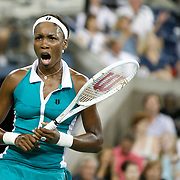 Venus Williams of the United States celebrates a point during her first round match against Kira Nagy of Hungary at the USTA Billie Jean King National Tennis Center on August 27, 2007 in the Flushing neighborhood of the Queens borough of New York City.