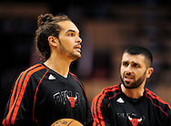 Nov. 14, 2012; Phoenix, AZ, USA; Chicago Bulls center Joakim Noah (13) and forward Vladimir Radmanovic (77) talk on the court prior to the game against the Phoenix Suns at the US Airways Center.  The Bulls defeated the Suns 112-106 in overtime. Mandatory Credit: Jennifer Stewart-USA TODAY Sports.