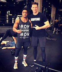 "Hugh Jackman releases a photo on Twitter with the following caption: """"With BAR Malik, the performance trainer, for the @nyknicks. He's helping me get ready for the stage. #TheManTheMusicTheShow #DOGPOUND"""". Photo Credit: Twitter *** No USA Distribution *** For Editorial Use Only *** Not to be Published in Books or Photo Books ***  Please note: Fees charged by the agency are for the agency's services only, and do not, nor are they intended to, convey to the user any ownership of Copyright or License in the material. The agency does not claim any ownership including but not limited to Copyright or License in the attached material. By publishing this material you expressly agree to indemnify and to hold the agency and its directors, shareholders and employees harmless from any loss, claims, damages, demands, expenses (including legal fees), or any causes of action or allegation against the agency arising out of or connected in any way with publication of the material."