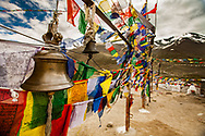 Tibetan Buddhist Prayer Flags and Bell in Himalayan Mountains, India